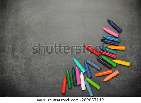 Still life, business, education concept. Black dusty chalkboard with crayons. Selective focus, copy space background, top view - stock photo