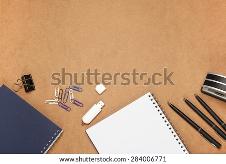 Still life, business, education concept. Office supplies, notepad, diary, stapler, USB flash drive and pens on a table. Selective focus, copy space background, top view - stock photo