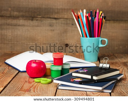Still life, business, education concept. School supplies and open notebook on a wooden table. Selective focus, copy space, school background - stock photo