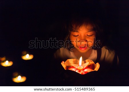 Still life candle light  girl holding  Krathong made from coconut cover wiht Loy Krathong festival.Concept for conservation.