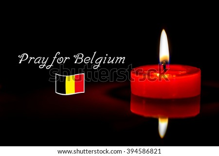 still life candle with text pray for Belgium background,candle flame at night. - stock photo