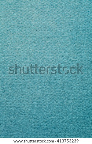 Still life close up design element of a blank blue piece of hand made cardboard paper with thick texture, plain background. Color backdrop with imperfections, full frame cyan sheet. - stock photo