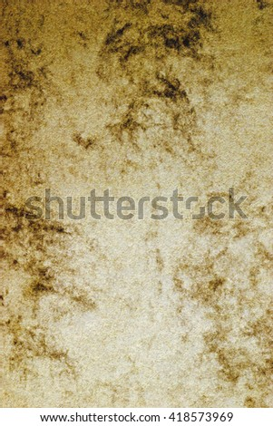 Still life close up design element of a blank golden yellow piece of cardboard paper with marble effect texture, plain background. Gold color backdrop with imperfections, full frame gold brown sheet. - stock photo