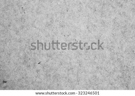 Still life close up detail of a rough splashed piece of writing paper with texture. Plain full frame background noise and textured detail in black and white colorless monotone neutral blank page. - stock photo