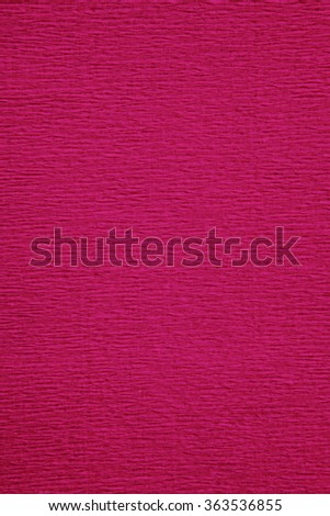 Still life close up detail of a wrinkly bright pink rough grungy piece of paper with horizontal lines thick texture. Full frame background with texture detail. Monotone magenta backdrop blank page. - stock photo