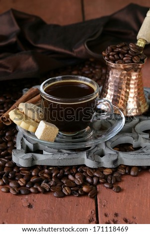 Still life coffee cup espresso beans and coffee pot on a wooden table