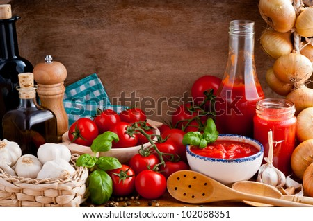 Still life composition with traditional homemade tomato sauce and ingredients - stock photo