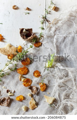 still life composition with vegetables and walnuts on jute napkin - stock photo