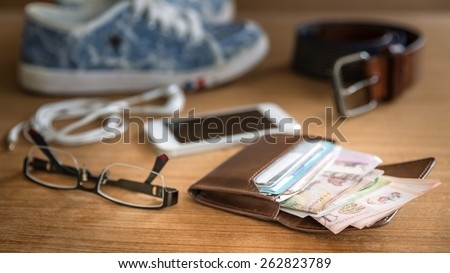 Still life concept of traveling all over the world with wallet - stock photo