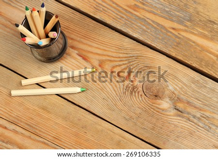 Still life concept. Pencils on a wooden table. Selective focus, copy space background, top view - stock photo