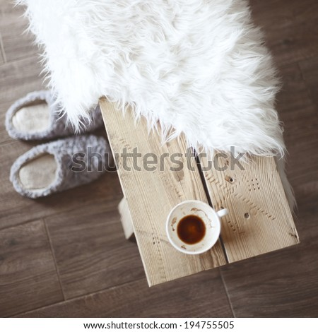 Still life details, cup of coffee on rustic bench, top view point - stock photo