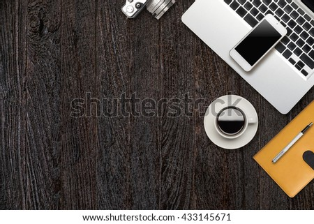 Still life details of laptop and smart phone empty white screen material office desktop on wooden desk top view. - stock photo