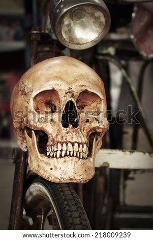 Still life fine art photography on human skeleton criminal concept at old bicycle - stock photo