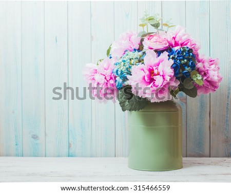 Still life - flowers in can - rustic style, shabby chic - stock photo
