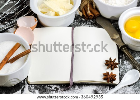 Still life, food and drink concept. Baking background with ingredients, sugar, flour, eggs, butter, spices for pie, easter cake, cookies on a grunge table. Selective focus, copy space - stock photo