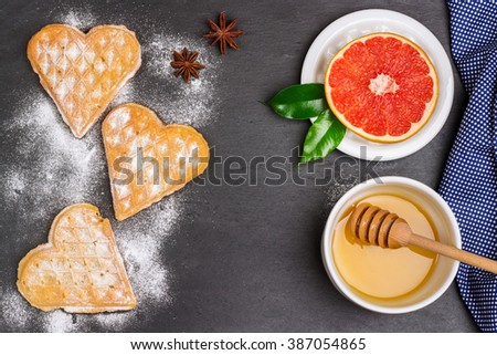 Still life, food and drink concept. Breakfast with belgian waffles on a grunge stone table. Selective focus, top view - stock photo