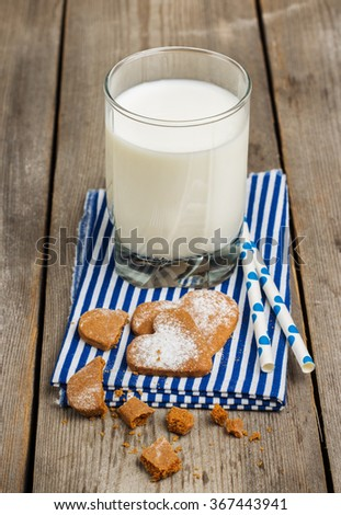 Still life, food and drink concept. Glass of milk on a rustic wooden table. Selective focus - stock photo