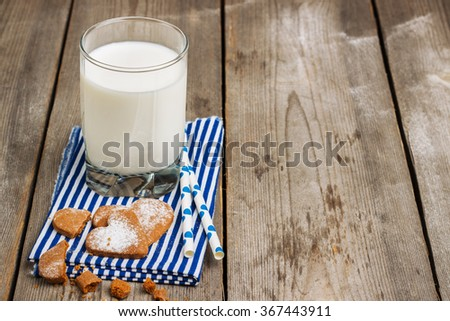 Still life, food and drink concept. Glass of milk on a rustic wooden table. Selective focus, copy space background - stock photo