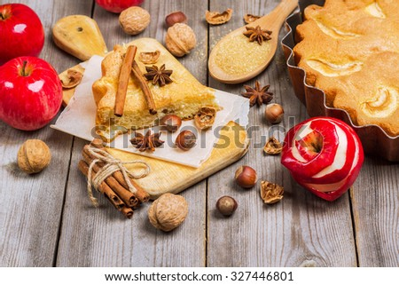 Still life, food and drink, seasonal concept. Apple pie nuts and spices (cinnamon and star anise) on a rustic wooden table. Selective focus - stock photo
