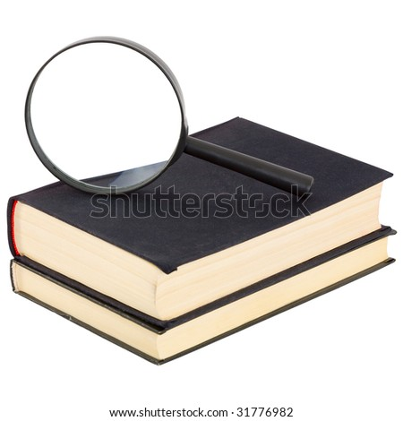 Still-life from a magnifier and a pile of old books on a white background - stock photo
