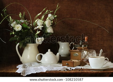 Still-life, gentle bouquet a snow-white flower and fragrant natural coffee with cognac