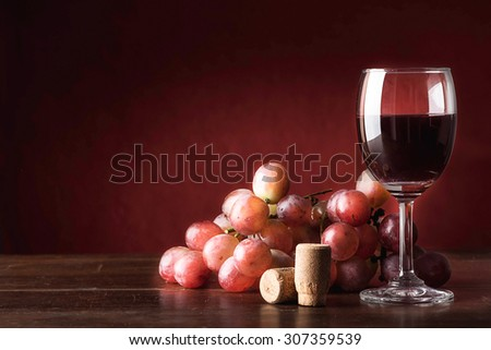 Still life glass of wine and grapes - stock photo