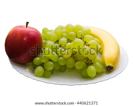 still life green grapes and apple and banana on a beautiful plate isolated on white background - stock photo