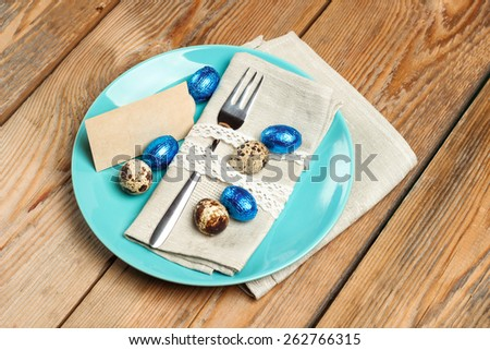 Still life, holidays, food and drink concept. Easter spring decoration with quail and chocolate eggs. Selective focus, top view - stock photo