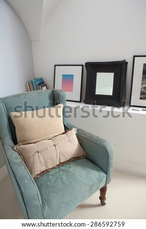 Still life home interior view of a traditional quality and luxurious wooden armchair with cushions in a stylish home living room, indoors. Elegant reading room, empty space, aspirational lifestyle. - stock photo