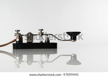 still life image of a morse code key on a white background - stock photo