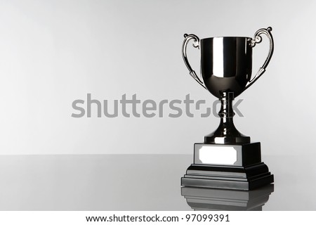 still life image of a single trophy standing in a white background - stock photo