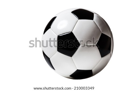 still life image of a traditional black and white football cut out - stock photo