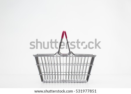 still life image of empty shopping basket