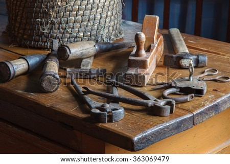 Still life in a rustic style: set of old joinery tools on a wooden table - stock photo