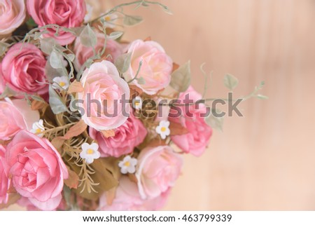 still life interior decoration pink rose flower on rustic wooden table background.( top view )