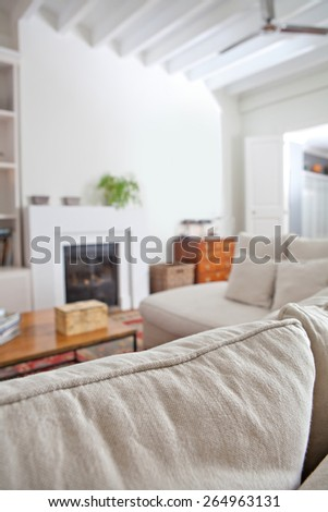 Still life interior design home living room with a comfortable and welcoming fireplace and a white sofa with cushions, interior detail. Aspirational and relaxing family room, indoors living lifestyle. - stock photo
