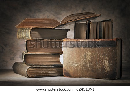 Still life made of old worn books. - stock photo
