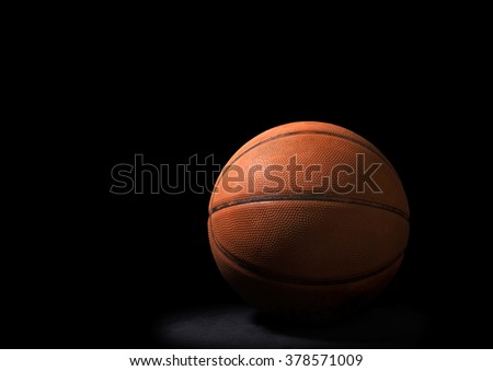 Still Life of a Basketball on Black Background - stock photo