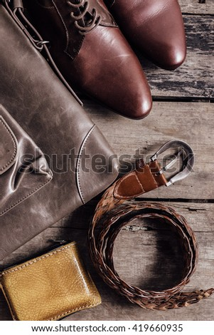 still life of accessories leather shoes ,billfold ,leather bags, belts on wooden background,top view - stock photo