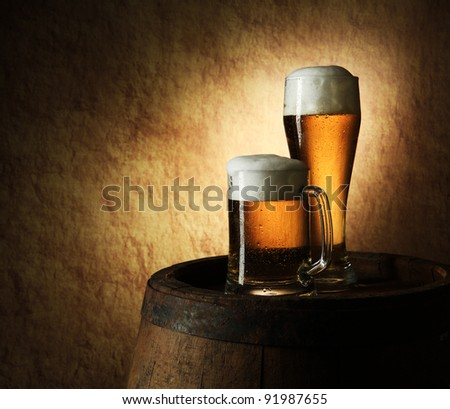 Still Life of beer and barrel on a grange background