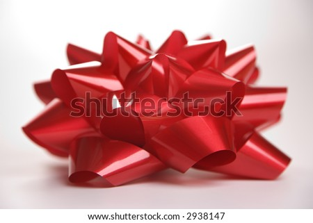 Still life of big red Christmas bow.
