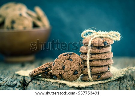 Still life of Close up stacked chocolate chip cookies on  napkin with rustic background