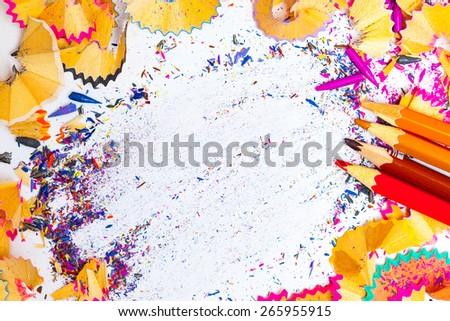 still life of colored pencil shavings and copy space - stock photo