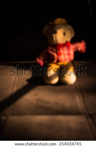 still life of cowboy bear on abstract background blur - stock photo
