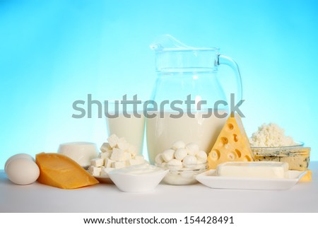 still life of dairy products and soft cheese varieties - stock photo