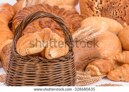 still life of different kinds of bread - selective focus - stock photo