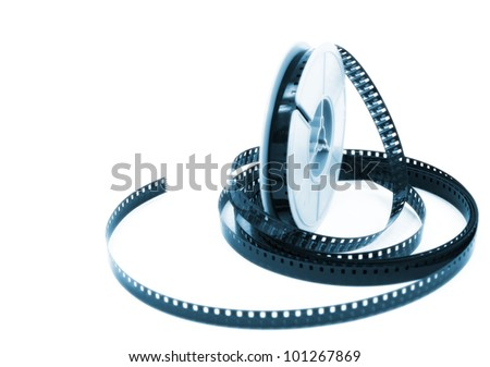 still life of dirty, old 8mm cine film and reel - stock photo