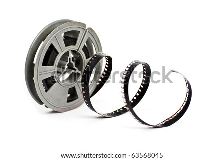 still life of dirty, old 8mm cine film and reel; isolated on white ground - stock photo