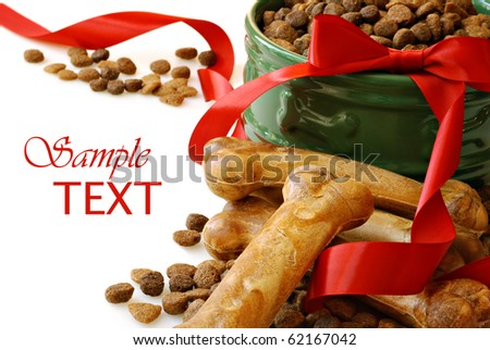 Still life of dog food and healthy treats with red ribbon on white background with copy space.  Macro with shallow dof. - stock photo