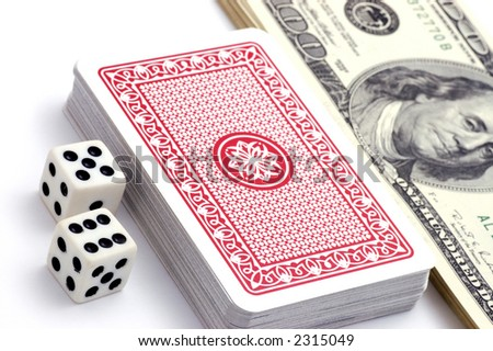 Still-life of dollars, bones and playing cards on white background - stock photo